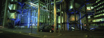 Car in front of an office building, Lloyds Of London, London, England by Panoramic Images