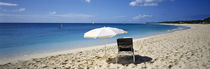 Single Beach Chair And Umbrella On Sand, Saint Martin, French West Indies by Panoramic Images