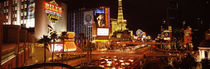 Buildings in a city lit up at night, The Strip, Las Vegas, Nevada, USA by Panoramic Images
