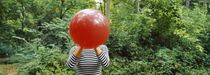 Woman blowing a balloon, Germany von Panoramic Images