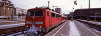 Train in winter at a railroad station, Innsbruck, Tyrol, Austria by Panoramic Images