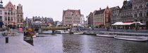 Tour boats docked at a harbor, Leie River, Graslei, Ghent, Belgium by Panoramic Images