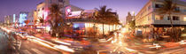 Traffic on a road, Ocean Drive, Miami, Florida, USA by Panoramic Images