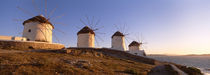 Low angle view of traditional windmills, Mykonos, Cyclades Islands, Greece by Panoramic Images