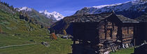 Log cabins on a landscape, Matterhorn, Valais, Switzerland by Panoramic Images