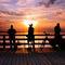 Three-angler-standing-on-a-bridge
