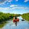 Girl-with-paddle-and-kayak