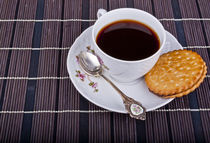 Cup of coffee and a cookie by Simeon Petrov