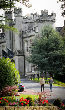 Young couple walking through Airth Castle Grounds by Buster Brown Photography