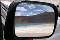 Reflection of the still blue waters of Pangong Tso in Ladakh by Ruchika Vyas
