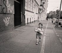 Young girl with baby: Berlin by Ron Greer