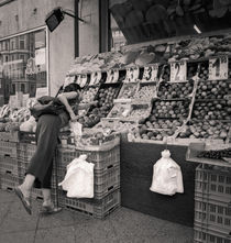 Woman and produce stand: Berlin by Ron Greer