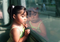girl's reflection in bus window Mexico City by Charles Harker