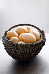 fresh eggs in a basket  by Kris Shopov
