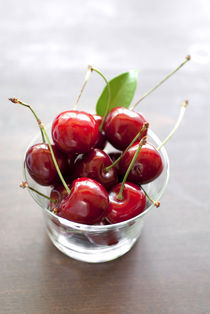 fresh cherries in a glass by Kris Shopov