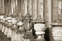 Ornate weathered Italian urns. by John Greim