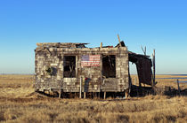 Abondoned shack with American flag by John Greim