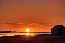 Sunrise over salt pond, Cape Cod, USA by John Greim