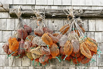 Bait bags hang from a dockside shed, Bass Harbor, Maine, USA by John Greim