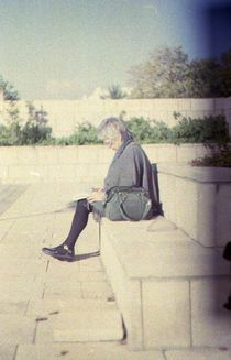 Woman Reading on Stairs by sannekurz