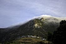 village under mountain by michal gabriel