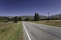 Road in  farmland by michal gabriel