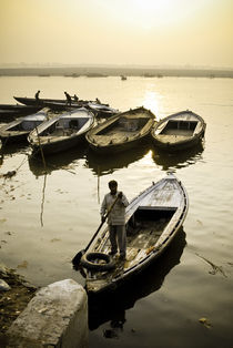 Boatman on the River Ganges by Russell Bevan Photography