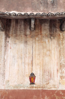 Old Lantern Hanging Against Wall by Neil Overy