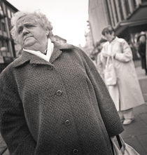 Woman in overcoat: Kassel, Germany by Ron Greer