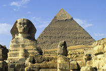 Sphinx with Chefren Pyramid In Background by Wolfgang Kaehler