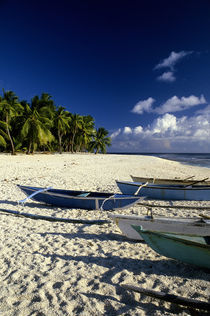 Outrigger Canoes on Beach by Wolfgang Kaehler