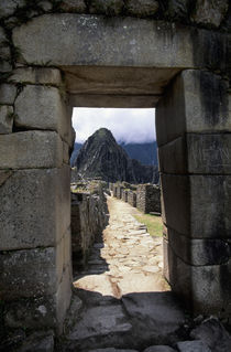 View of Huayna Picchu Through Entrance Door by Wolfgang Kaehler