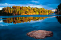 Early Evening reflections in the boundry waters of Minnesota-Ontario by Danita Delimont