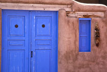 View of blue door and window in adobe structure von Danita Delimont