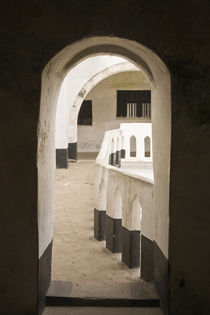 View of Cape Coast Castle from doorway by Danita Delimont