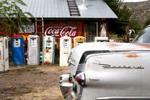 Vintage car and gasoline pumps by Danita Delimont