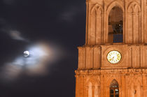 Evening sky with moon and church clock by Danita Delimont