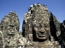 Enigmatic and huge carved heads of the Bayon by Danita Delimont