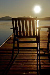 A chair with a view of Moosehead Lake in the early morning by Danita Delimont