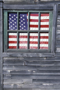 Flag of the United States in window of abandoned store by Danita Delimont