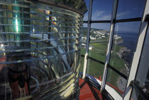 Lightbulb and fresnel lens at Cap-de-Rosiers Lighthouse by Danita Delimont