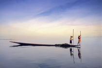 (Myanmar) Fishing boat reflected on Inle Lake von Danita Delimont