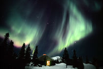 Aurora Borealis in the night sky above a yurt by Danita Delimont