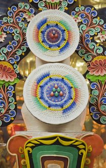 Ceremonial cakes made by monks adorn the altar in a Buddhist temple by Danita Delimont