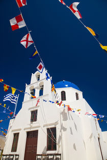 Greece and Greek Island of Santorini town of Oia Blue Domed Church with flags flying by Danita Delimont