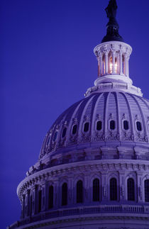 S Capitol at dusk with light in dome on showing that Congress is in session by Danita Delimont