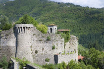 Italy - A rundown stone castle set in a valley by Danita Delimont