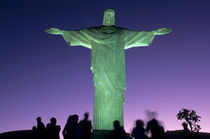 The Christ Statue on Corcovado mountain at night with greenish floodlights by Danita Delimont