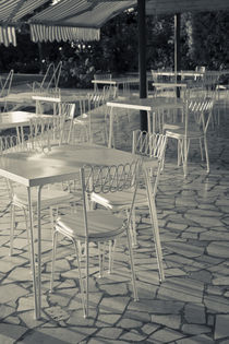 Lakeside cafe tables by Danita Delimont