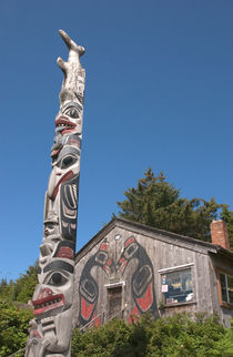 Haida totem pole and tourist shop by Danita Delimont